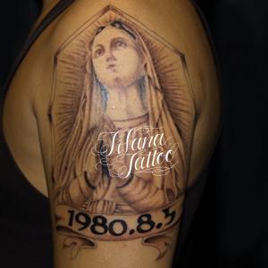 マリア様と日付のタトゥー