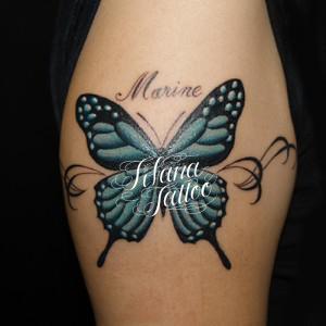 水色の蝶のタトゥー