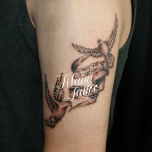 鳩のタトゥー