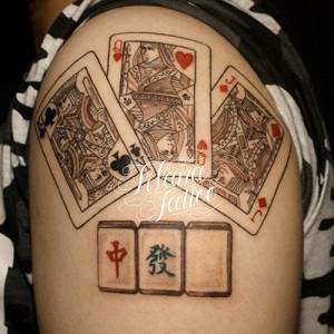 トランプと牌のタトゥー