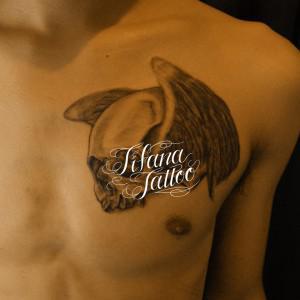 翼が生えたスカルのタトゥー