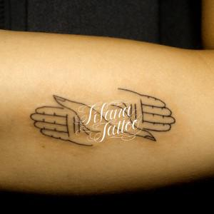 Hand Sign Tattoo