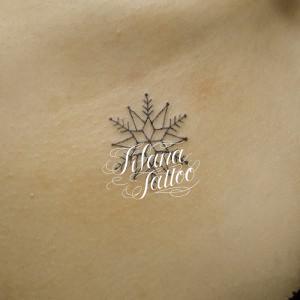 雪の結晶のタトゥー